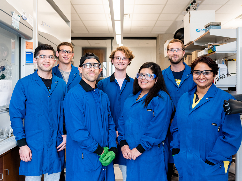 group of students in lab coats in lab